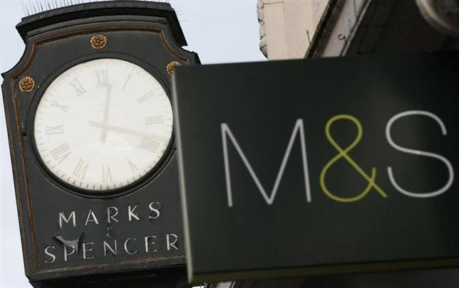 Marks & Spencer signs are seen outside outside a store in London January 8, 2014. REUTERS/Stefan Wermuth/Files