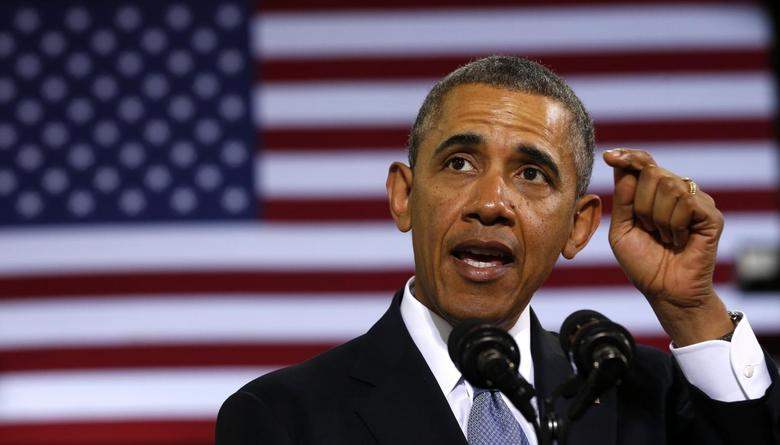 U.S. President Barack Obama delivers remarks on the economy at the Safeway Distribution Center in Upper Marlboro, Maryland February 18, 2014. REUTERS/Kevin Lamarque