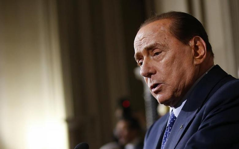 Leader of Forza Italia party Silvio Berlusconi talks to reporters at the end of the consultations with Italian President Giorgio Napolitano at the Quirinale Palace in Rome February 15, 2014. REUTERS/Tony Gentile