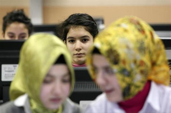 Turkish girls attend computer lessons at the Kazim Karabekir Girls' Imam-Hatip School in Istanbul February 10, 2010. REUTERS/Murad Sezer/Files
