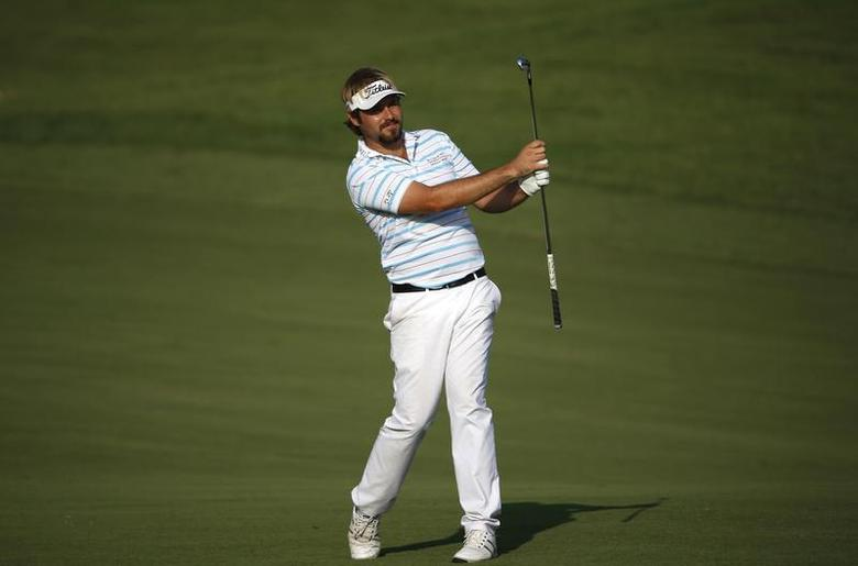 Victor Dubuisson of France hits the ball on the 14th hole during the third round of the DP World Tour Championship in Dubai November 16, 2013. REUTERS/Ahmed Jadallah