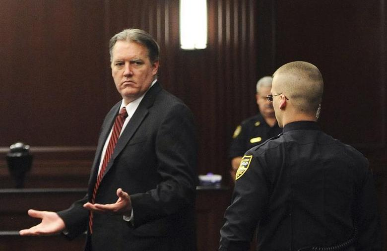Michael Dunn (L) raises his hands in disbelief as he looks toward his parents after the verdicts were announced in his trial in Jacksonville, Florida February 15, 2014. REUTERS/Bob Mack/Florida Times-Union/Pool