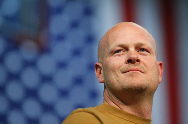 Joe Wurzelbacher, also known as ''Joe the Plumber,'' stands onstage at a campaign rally with U.S. Republican presidential nominee Senator John McCain in Mentor, Ohio in this file photo taken October 30, 2008. REUTERS/Brian Snyder/Files