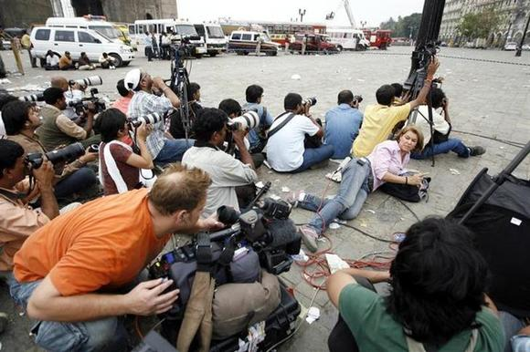 Photographers and members of the media cover a gunfire at the Taj Hotel in Mumbai November 28, 2008. REUTERS/Desmond Boylan/Files