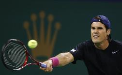 Tommy Haas of Germany hits a shot against Sam Querrey of the U.S. during their men's singles match at the Shanghai Masters tennis tournament October 7, 2013. REUTERS/Aly Song