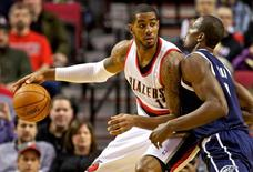 Feb 11, 2014; Portland, OR, USA; Portland Trail Blazers power forward LaMarcus Aldridge (12) posts up against Oklahoma City Thunder power forward Serge Ibaka (9) during the first quarter at the Moda Center. Mandatory Credit: Craig Mitchelldyer-USA TODAY Sports
