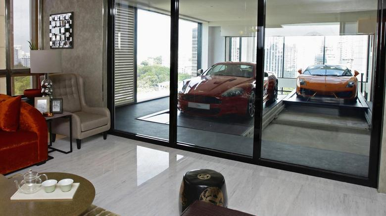 A Lamborghini Gallardo (R) arrives at an ensuite elevated garage on a 14th floor luxury apartment at the Hamilton Scotts luxury residence in Singapore in this August 23, 2012 file photo. REUTERS/Tim Chong/Files