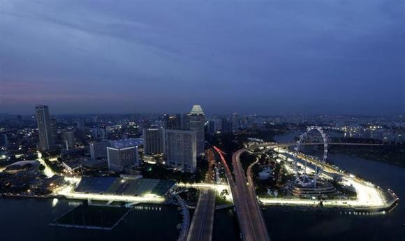 The Marina Bay street circuit is illuminated at dusk in Singapore September 18, 2013. REUTERS/Pablo Sanchez/Files