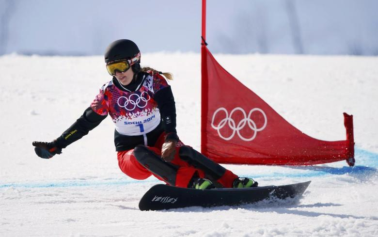 Switzerland's Patrizia Kummer competes during the women's snowboard parallel giant slalom finals at the 2014 Sochi Winter Olympic Games in Rosa Khutor February 19, 2014. REUTERS/Mike Blake