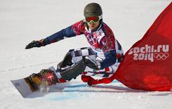 Russia's Vic Wild competes during the men's snowboard parallel giant slalom qualification run at the 2014 Sochi Winter Olympic Games in Rosa Khutor February 19, 2014. REUTERS/Lucas Jackson