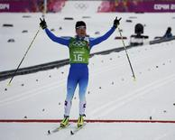 Finland's Sami Jauhojaervi wins in the men's cross-country team sprint classic final during the 2014 Sochi Winter Olympics February 19, 2014. REUTERS/Stefan Wermuth