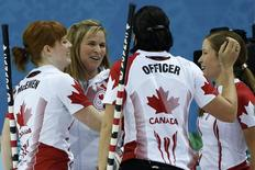 Canada's lead Dawn McEwen, skip Jennifer Jones, Jill Officer and vice Kaitlyn Lawes (L-R) celebrate after winning their women's curling semifinal game against Britain at the 2014 Sochi Winter Olympics in the Ice Cube Curling Center in Sochi February 19, 2014. REUTERS/Jim Young