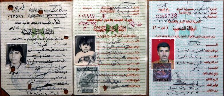 Citizenship identification cards issued by the Iraqi government shows Abeer Qassim Hamza al-Janabi (C) in 1993 with a date of birth of August 19, 1991, as translated from the identity card, her mother Fakhriya Taha Muheisin al-Janabi (L), in 1990, and her father Qasim Hamza Rasheed al-Janabi, in 2006, in this handout photo from their relatives in Baghdad July 9, 2006. REUTERS/Handout