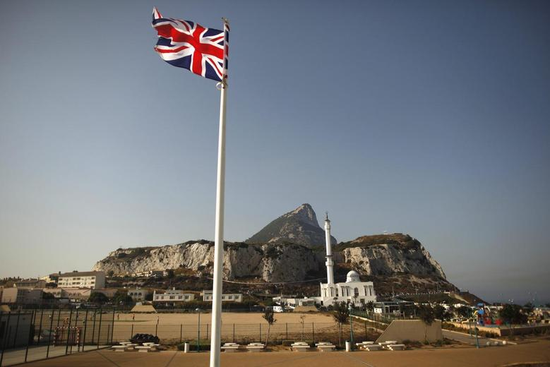 A Union flag flies at Europa Point in front of the Rock (rear), a monolithic limestone promontory, and the Ibrahim-al-Ibrahim mosque in Gibraltar, south of Spain August 12, 2013. REUTERS/Jon Nazca