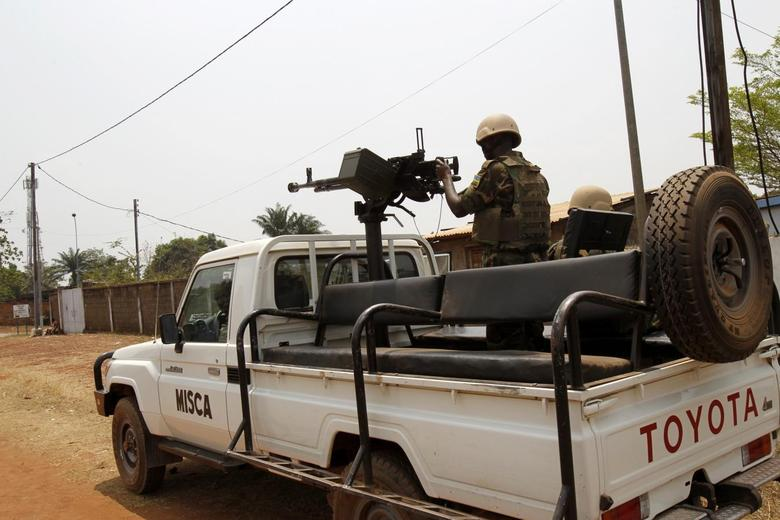 A member of the African peacekeeping forces stands in a pickup truck in Bangui February 19,2014. REUTERS/Luc Gnago