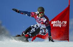 Russia's Vic Wild competes during the men's snowboard parallel giant slalom qualifying heats at the 2014 Sochi Winter Olympic Games in Rosa Khutor February 19, 2014. REUTERS/Mike Blake