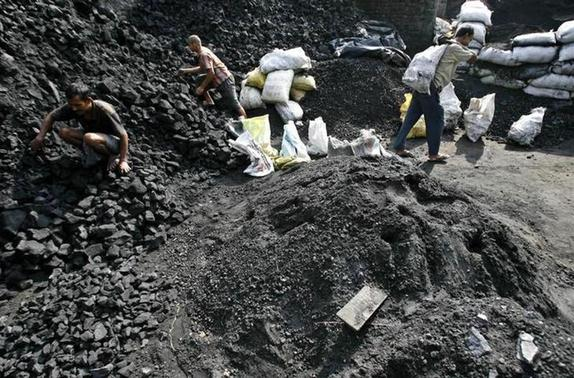 Labourers work at a coal warehouse in Siliguri April 8, 2009. REUTERS/Rupak De Chowdhuri/Files