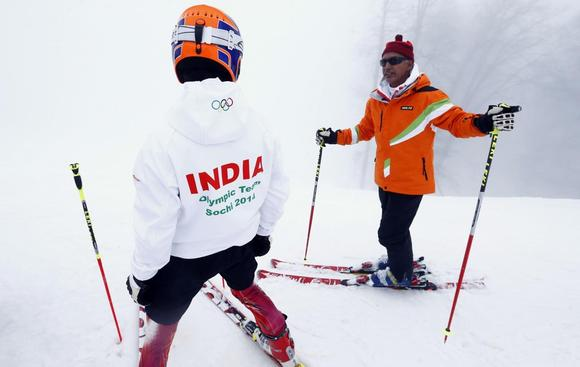 India's Himanshu Thakur (L) listens to his coach as he attends an Alpine skiing training session during the 2014 Sochi Winter Olympics at the Rosa Khutor Alpine Center February 17, 2014. REUTERS/Ruben Sprich