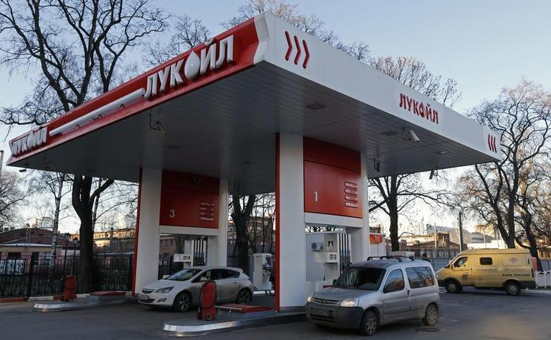 Vehicles are parked at a Lukoil petrol station in St. Petersburg November 26, 2013. REUTERS/Alexander Demianchuk