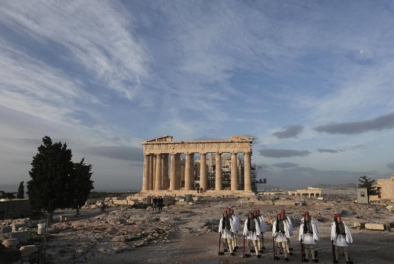 Greek Presidential Guards stand in front of the Parthenon temple during the flag hoisting ceremony at the Acropolis hill in Athens November 21, 2013. REUTERS/John Kolesidis