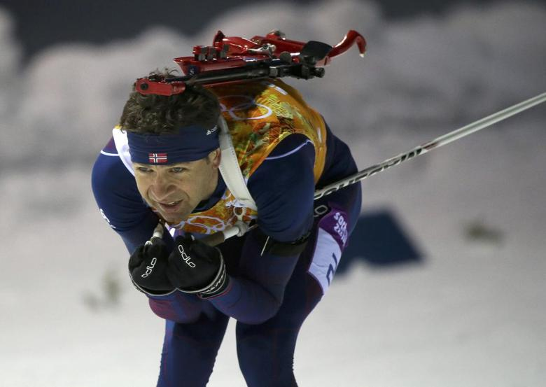 Norway's Ole Einar Bjoerndalen skis during the mixed biathlon relay at the Sochi 2014 Winter Olympics February 19, 2014. REUTERS/Sergei Karpukhin