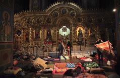 People rest inside Mikhailovsky Zlatoverkhy Cathedral (St. Michael's Golden-Domed Monastery), which serves as a temporary shelter and a first-aid post for anti-government protesters, in Kiev February 19, 2014. REUTERS/David Mdzinarishvili