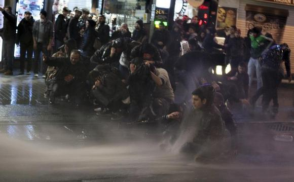 Riot police use water cannons to disperse demonstrators during a protest against internet censorship in Istanbul February 8, 2014. REUTERS/Nazim Serhat Firat