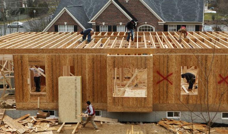 Workers build a new house in Alexandria, Virginia February 16, 2012. REUTERS/Kevin Lamarque