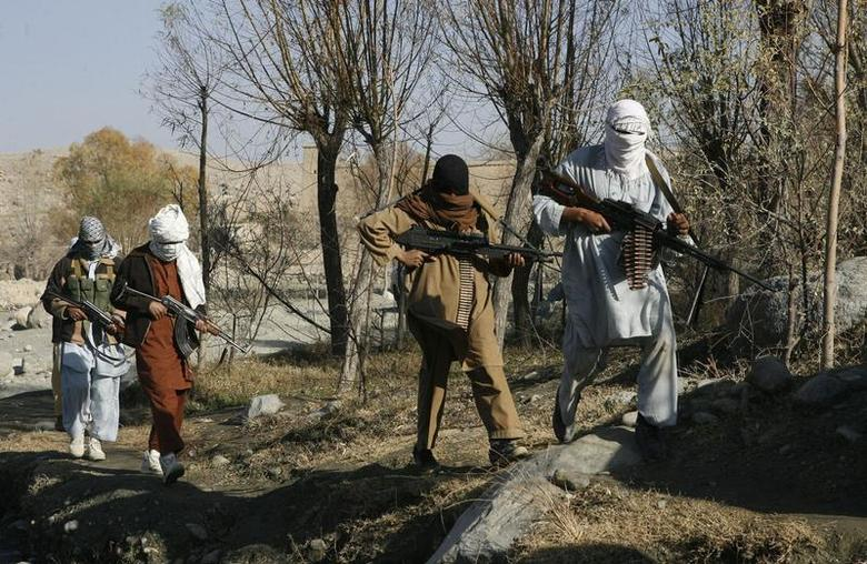 Taliban fighters pose with weapons in an undisclosed location in Nangarhar province in this December 13, 2010 picture. REUTERS/Stringer