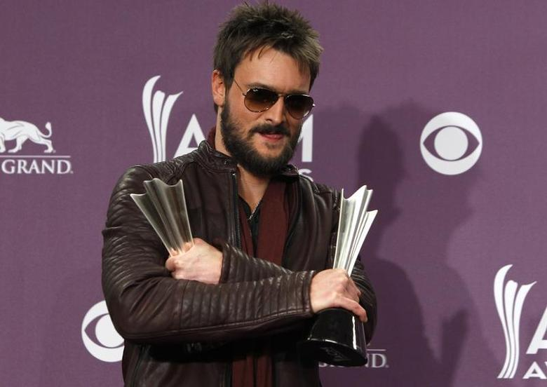 Eric Church holds his awards for album of the year and vocal event of the year at the 48th ACM Awards in Las Vegas April 7, 2013. REUTERS/Steve Marcus