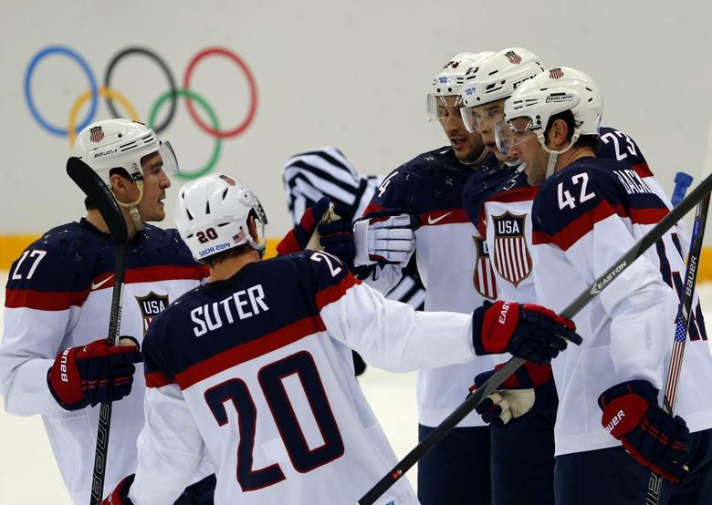 Team USA's David Backes (42) is congratulated by teammates after scoring a goal against Czech Republic during the first period of their men's quarter-finals ice hockey game at the 2014 Sochi Winter Olympic Games February 19, 2014. REUTERS/Laszlo Balogh