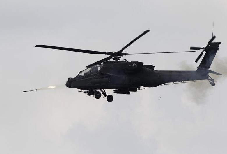 The U.S. Army's AH-64 Apache helicopter attends a live-fire exercise of South Korean and U.S. armed forces, held to mark the 62nd anniversary of the start of the Korean War, during a media day of the fire exercise in Pocheon, 46 km (29 miles) northeast of Seoul, June 19, 2012. REUTERS/Kim Hong-Ji