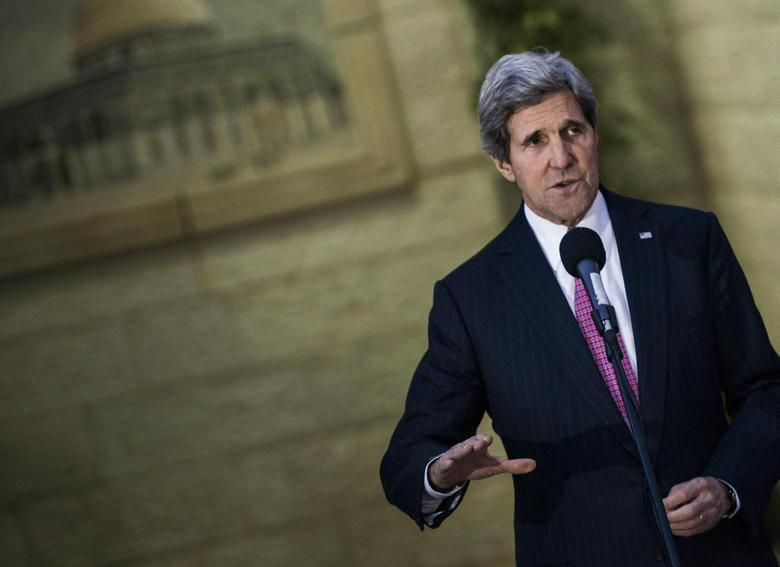 U.S. Secretary of State John Kerry speaks to the media after a meeting with Palestinian negotiator Saeb Erekat and Palestinian President Mahmoud Abbas in the West Bank city of Ramallah January 4, 2014 file photo. REUTERS/Brendan Smialowski/Pool