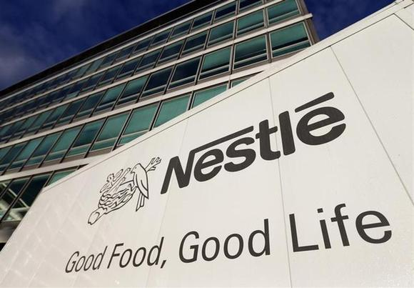 The Nestle logo is pictured on a truck outside the company's headquarters before the nine-month sale figures news conference in Vevey October 17, 2013. REUTERS/Denis Balibouse/Files
