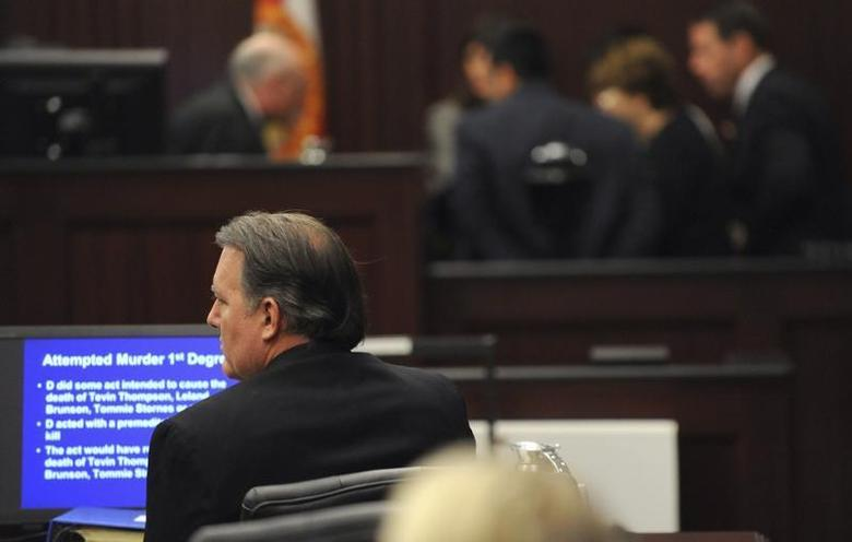 Michael Dunn sits in the courtroom during closing arguments at his murder trial in the shooting death of unarmed teen Jordan Davis, in Jacksonville, Florida February 12, 2014. REUTERS/Bob Mack/Pool