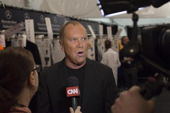 Designer Michael Kors is interviewed before his Autumn/Winter 2013 collection show during New York Fashion Week February 13, 2013. REUTERS/Andrew Kelly
