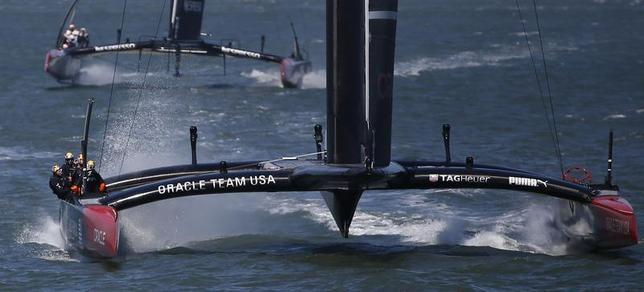 Oracle Team USA sails toward the finish line ahead of Emirates Team New Zealand to win Race 17 of the 34th America's Cup yacht sailing race in San Francisco, California September 24, 2013. REUTERS/Stephen Lam