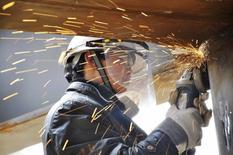 L'activité industrielle en Chine s'est de nouveau contractée en février, selon les premiers résultats de l'enquête mensuelle Markit-HSBC auprès des directeurs d'achats. /Photo prise le 15 février 2014/REUTERS/China Daily