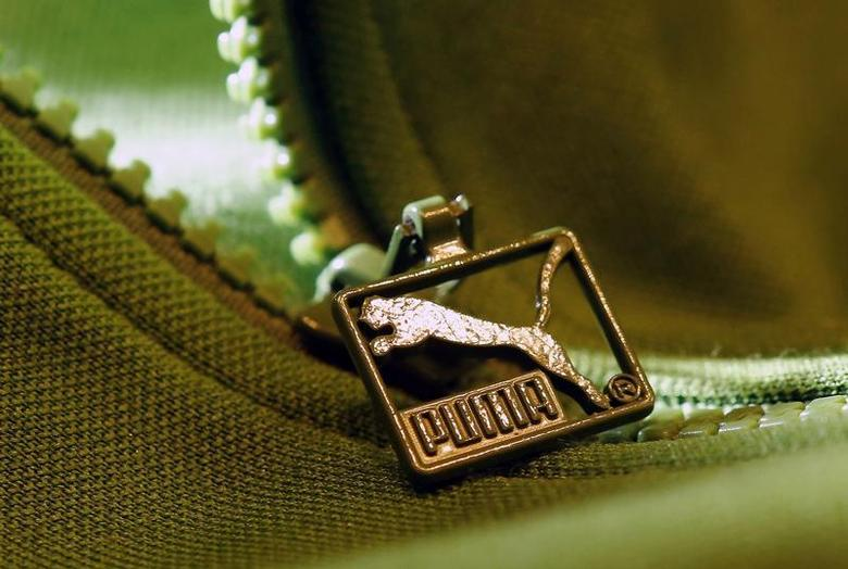 A Puma logo is pictured on a zipper, in Herzogenaurach near Nuremberg October 23, 2013. REUTERS/Ralf Roedel/Handout via Reuters