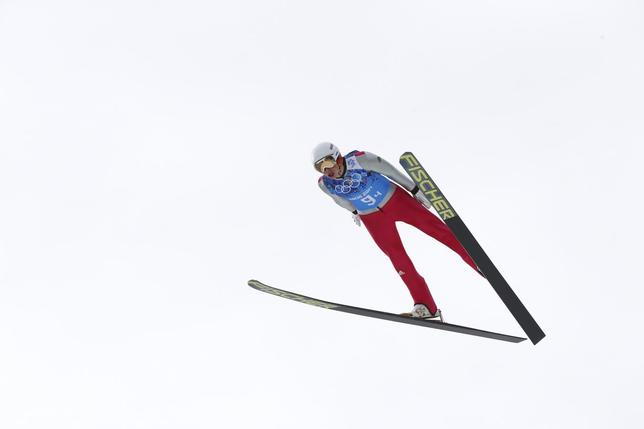 Germany's Eric Frenzel soars through the air during the trial round of the large hill ski jumping portion of the Nordic Combined team Gundersen event of the Sochi 2014 Winter Olympic Games, at the RusSki Gorki Ski Jumping Center in Rosa Khutor, February 20, 2014. REUTERS/Michael Dalder