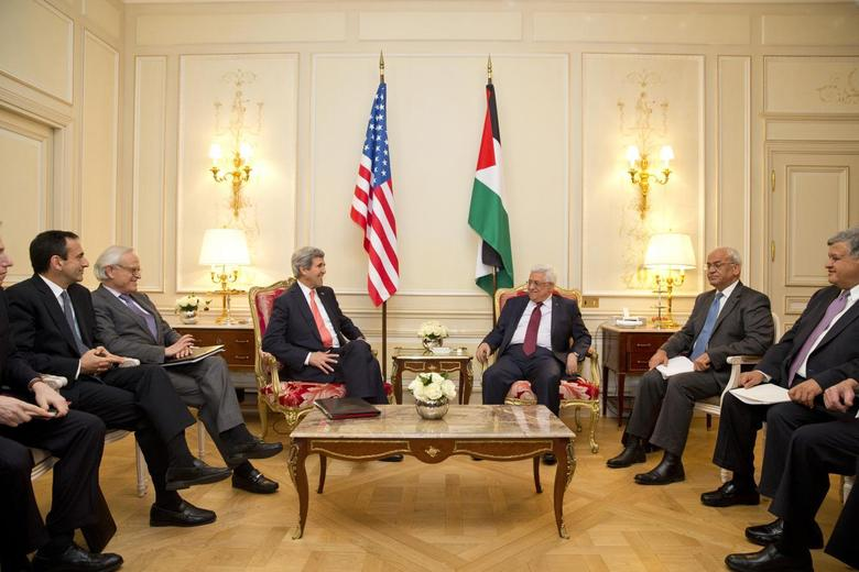 U.S. Secretary of State John Kerry (L) sits with Palestinian President Mahmoud Abbas during their talks in Paris February 19, 2014. REUTERS/Evan Vucci/Pool