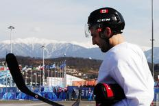 Canada's ice hockey player Patrice Bergeron walks to the Bolshoy arena following a men's team practice at the 2014 Sochi Winter Olympics February 20, 2014. REUTERS/Brian Snyder
