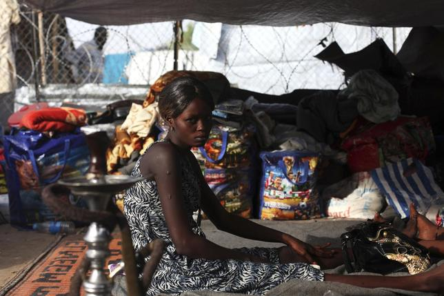 A South Sudanese woman, who has been displaced by the fighting, sits in a tent in a camp for displaced persons in the United Nations Mission in South Sudan (UNMISS) compound in Tongping in Juba, February 19, 2014. REUTERS/Andreea Campeanu