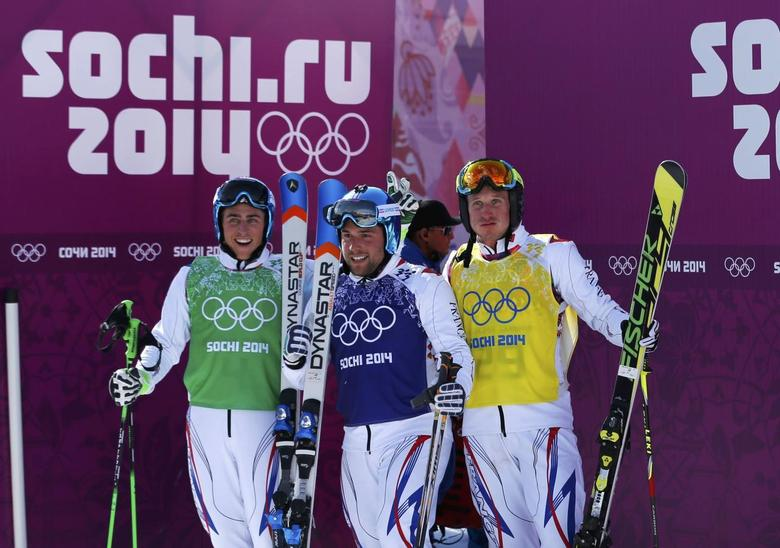 From L-R: France's winner Jean Frederic Chapuis, second-placed Arnaud Bovolenta and third-placed Jonathan Midol pose after their men's freestyle skiing skicross finals at the 2014 Sochi Winter Olympic Games in Rosa Khutor February 20, 2014. REUTERS/Mike Blake