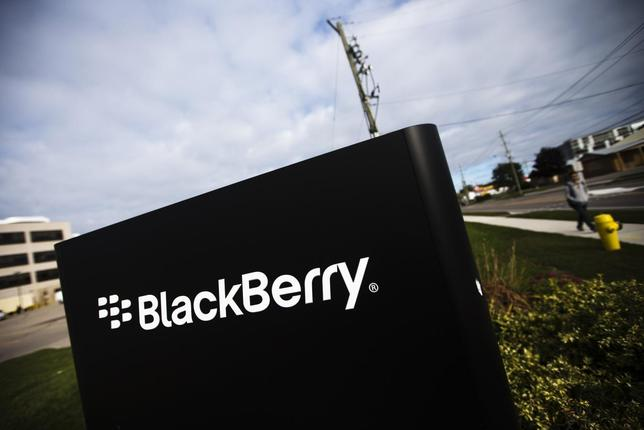 A man walks by a Blackberry sign at the Blackberry campus in Waterloo, September 23, 2013. REUTERS/Mark Blinch