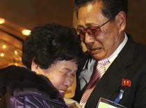 North Korean Lee Yun-geun (R), 72, hugs his South Korean sister Lee Sun-hyang, 88, during their family reunion at the Mount Kumgang resort in North Korea February 20, 2014. REUTERS/Lee Ji-eun/Yonhap