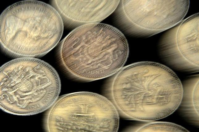 A pile of one pound coins is seen in central London June 17, 2008. REUTERS/Toby Melville