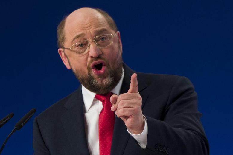Martin Schulz, top-candidate of the Social Democratic Party (SPD) in this year's European Parliament elections, delivers a speech outlining the program of his campaign to become the next President of the European Commission, during a SPD extraordinary congress in Berlin January 26, 2014. REUTERS/Thomas Peter