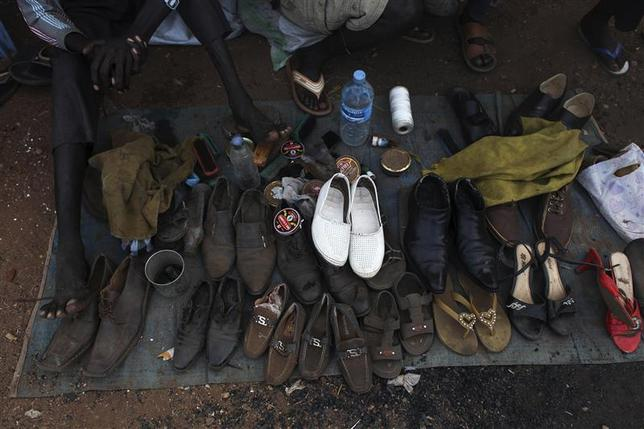 Shoes belonging to South Sudanese people displaced by the fighting wait to be cleaned in a camp for displaced persons in the UNMISS compound in Tongping in Juba February 19, 2014. REUTERS/Andreea Campeanu
