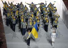 Ukraine's flag-bearer Valentina Shevchenko leads her country's contingent during the athletes' parade at the opening ceremony of the 2014 Sochi Winter Olympics, February 7, 2014. REUTERS/Lucy Nicholson